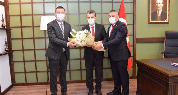 AK Parti Trabzon İl ve İlçe Yönetim Kurullarından Kaymakam Tolga Toğan'a ziyaret